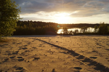 sunset over sand at cyrtsal waters lake, bawsey, king's lynn