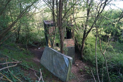 wooden structure amongst trees - abandoned shelter on dismantled railway next to a47