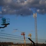 radio mast, pigeon in flight and cherry picker