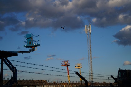 radio mast, pigeon in flight and cherry picker