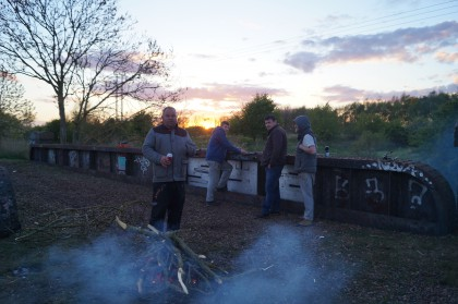 romany men fishing from nar valley way railway bridge