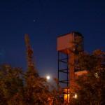 waxing gibbous moon behind building