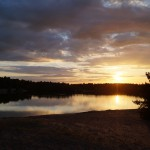 sunset over crystal waters lake, bawsey, king's lynn