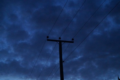 silhouette of powerline pole against deep blue sky at dusk, bawsey, king's lynn