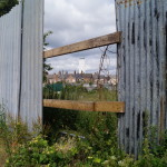 bentinck docks grain silo visible through fence at rope walk