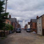 view down walker street with bentinck docks grain silo in background