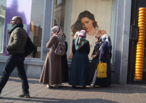 women outside clothing store in amsterdam