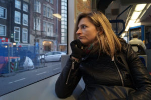 woman looking out of bus window in amsterdam