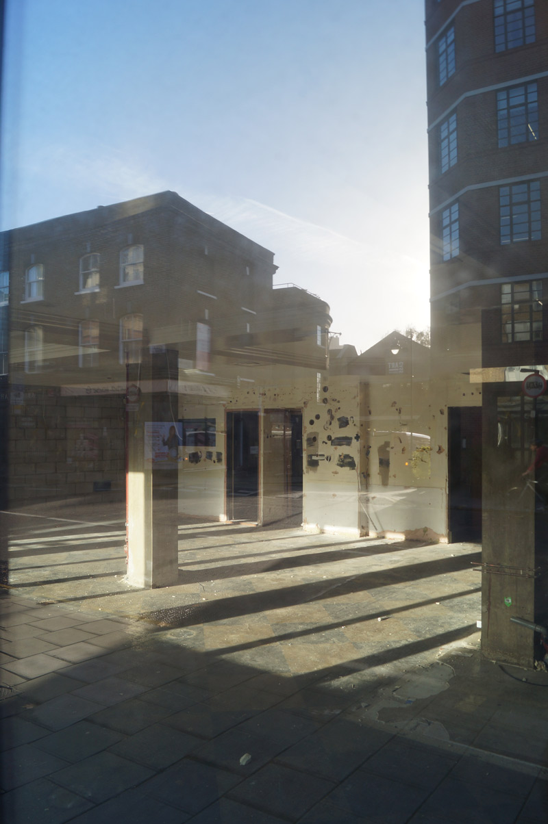 islington street photography sunlight vacant shop interior through window with reflections