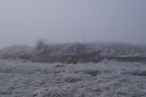 king's lynn nar loop boat wreck in frozen grass and mist