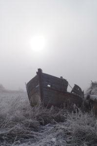 king's lynn nar loop boat wreck silhouette in fog