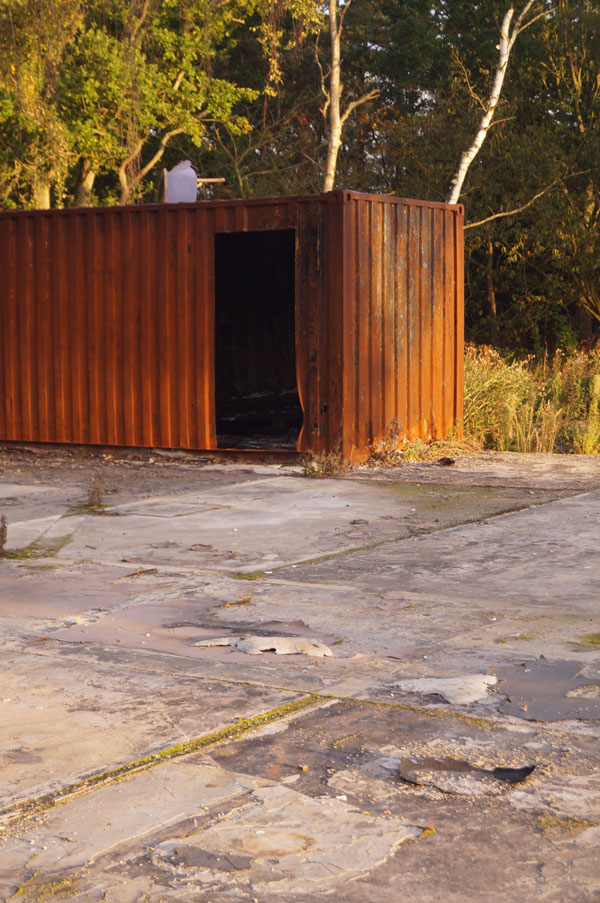 rusty, fire-damaged storage container